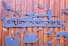Enjoy your park sign. With cutouts and animals at Rushcliffe country park nottinghamshire Royalty Free Stock Images