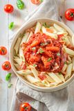 Enjoy your penne bolognese with bacon and herbs Royalty Free Stock Images