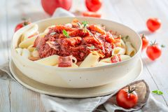 Enjoy your penne bolognese made of fresh tomatoes Stock Photography