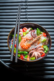 Enjoy your seafood noodle with octopus and shrimps Royalty Free Stock Photo