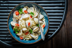 Enjoy your spaghetti Vongole with clams, parsley and peppers Stock Images