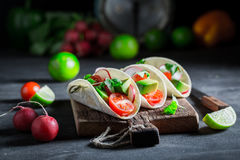 Enjoy your tacos as a snack for a party. On black table Royalty Free Stock Photography