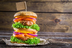 Enjoy your tasty double-decker hamburger Stock Photography