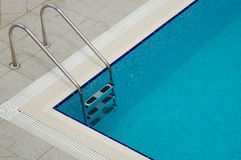 Enjoy your time. Swimming pool handrails inviting you to have a swim Royalty Free Stock Images