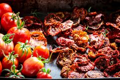 Enjoy your tomatoes dried in the sun stock photo