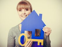 Enjoyable estate agent with house ang key royalty free stock images