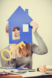 Enjoyable estate agent with house ang key. Stock Photos