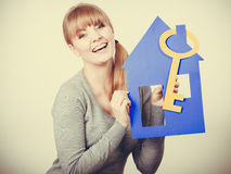 Enjoyable estate agent with house ang key. Stock Photo