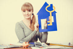 Enjoyable estate agent with house ang key. Royalty Free Stock Photos