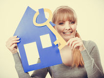 Enjoyable estate agent with house ang key. Stock Images