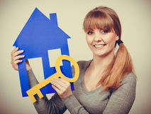 Enjoyable estate agent with house ang key. Royalty Free Stock Images