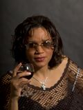 Enjoying. Woman with glass of red wine Stock Photography