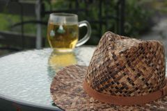 Enjoying the afternoon breeze. Relaxing and enjoying the afternoon breeze. Apple juice mixed with cool natural local water and my hat royalty free stock photo