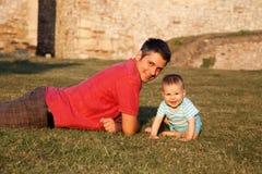 Enjoying afternoon sun. Father and son enjoying afternoon sunshine Stock Image
