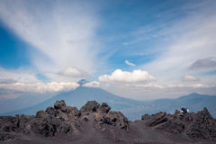 Enjoying Agua Volcano View in Guatemala. View from the base of Volcano Pacaya with characteristic volcanic rock formations. Tourists are enjoying the view of royalty free stock photo