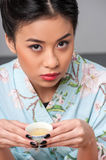 Enjoying asian tea ceremony Royalty Free Stock Image