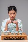 Enjoying asian tea ceremony Royalty Free Stock Photo