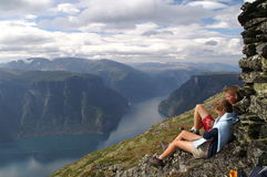 Enjoying the Aurlandsfjord. Girl and boy having a great view to the Aurlandsfjord from a mountain top Stock Photos
