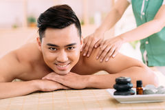 Enjoying back massage Royalty Free Stock Images
