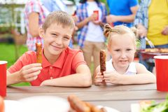 Enjoying barbecued sausages Stock Image