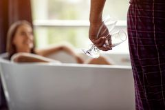 Enjoying a bath with champagne in a glasses -couple relaxing together in the bathtub royalty free stock photo