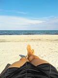 Enjoying the beach - male feet, sand, ocean Royalty Free Stock Photos