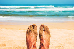 Enjoying beach in summer. Point of view of man& x27;s feet in front of the beach Stock Photography