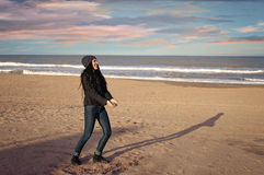 Enjoying the beach in winter. Teenager playing in winter in a beach of Mar del Plata, Argentina Stock Images
