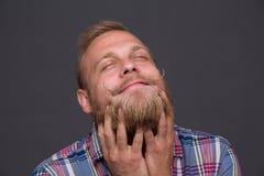 Enjoying bearded man Stock Image