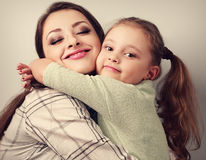Enjoying beautiful mother cuddling emotional cute kid girl in st Royalty Free Stock Images