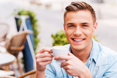 Enjoying the best coffee in town. Royalty Free Stock Photography