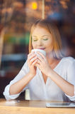 Enjoying the best coffee in town. Royalty Free Stock Image