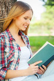 Enjoying book and fresh air. Royalty Free Stock Photos
