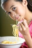 Enjoying bowl of spaghetti Stock Photos
