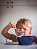 Boy eating breakfast Royalty Free Stock Photo