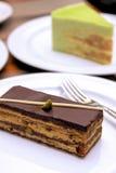 Enjoying cakes Stock Image