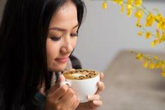 Enjoying cappuccino Stock Photo