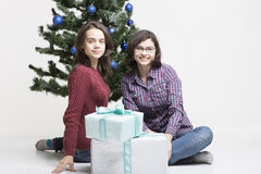 Enjoying Christmas gifts Stock Images