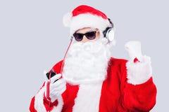 Enjoying Christmas music. Royalty Free Stock Images