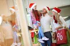 Enjoying Christmas shopping Stock Images