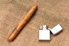 Enjoying a Cigar. Cigar and Lighter on Basket Lining for smoking presentations and tobacco industry purpose Royalty Free Stock Photography