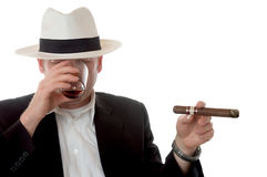 Enjoying a cigar and whiskey Royalty Free Stock Photography