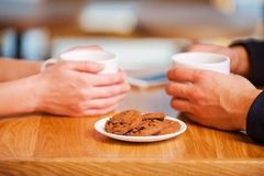 Enjoying closeness. Close-up of couple enjoying fresh coffee in cafe together Stock Photos