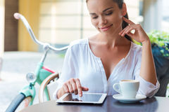 Enjoying coffee break in cafe. Royalty Free Stock Image