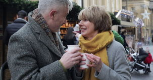 Enjoying coffee at the christmas market stock footage