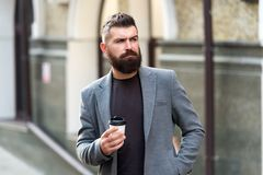 Enjoying coffee on the go. Businessman well groomed appearance enjoy coffee break out of business center. Relax and. Recharge. Man bearded hipster drinking royalty free stock photography