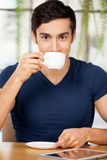 Enjoying coffee at the restaurant. Royalty Free Stock Images