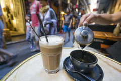 Enjoying coffee and tea in a laneway