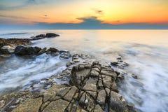 Enjoying the colorful sunset on a beach with rocks on the Adriatic Sea coast Istria Croatia. Colorful sunset on a beach with rocks on the Adriatic Sea coast royalty free stock photos
