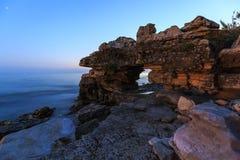 Enjoying the colorful sunset on a beach with rocks on the Adriatic Sea coast Istria Croatia. Colorful sunset on a beach with rocks on the Adriatic Sea coast royalty free stock photo
